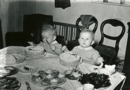 The Miles twins celebrate their birthday with cakes and crackers (1952)