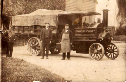 PH 18626 shows a dray being pulled by a steam engine, with George Constable Brewery in Arundel staff including drayman, Mr Mates, standing in front. The photograph is dated c1900.
