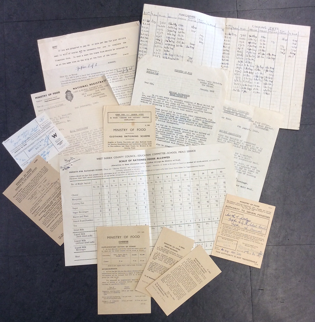 Image shows ten or so leaflets and notes regarding the supply of food to the school, including scale of rationed foods allowed, orders of margarine and cooking fat needed each month, requests for more allowances and notices on rationing portions