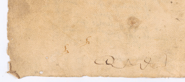 A sheet of paper with doodled letters at the bottom of the page.