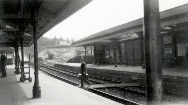 Railway employee crosses the track at Midhurst Station.