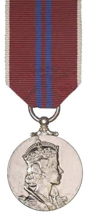 Example image of a coronation medal which has a red and blue ribbon and silver medal with Elizabeth II's portrait on it.