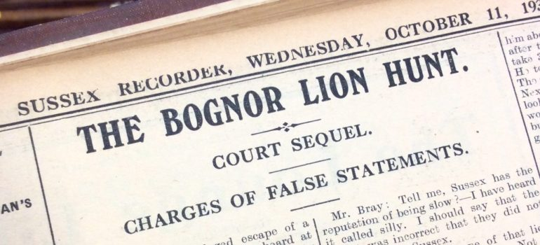 Close up image of a newspaper headline about the court trial