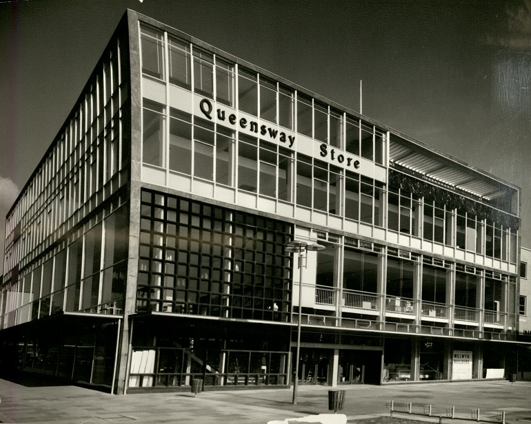 Exterior shot of the square building.