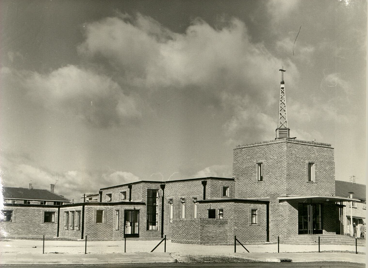 Exterior photograph of the brick and square block style church.