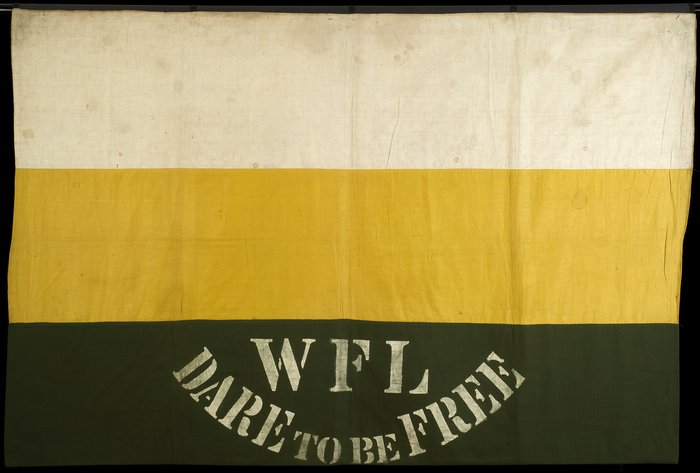 Flag shape with three horizontal stripes, white (top), yellow (middle), dark green (bottom), with 'WFL Dare to be Free' printed in white on the bottom stripe