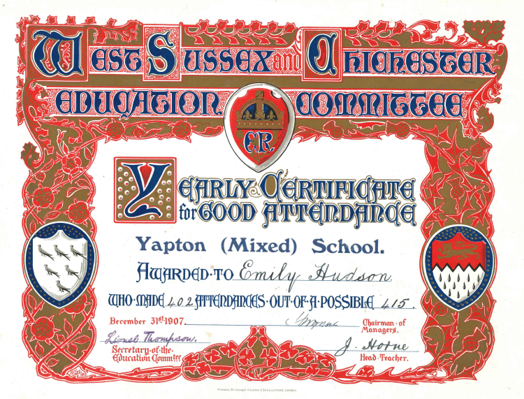 A large and ornate certificate decorated with a thick red, blue and gold floral border.