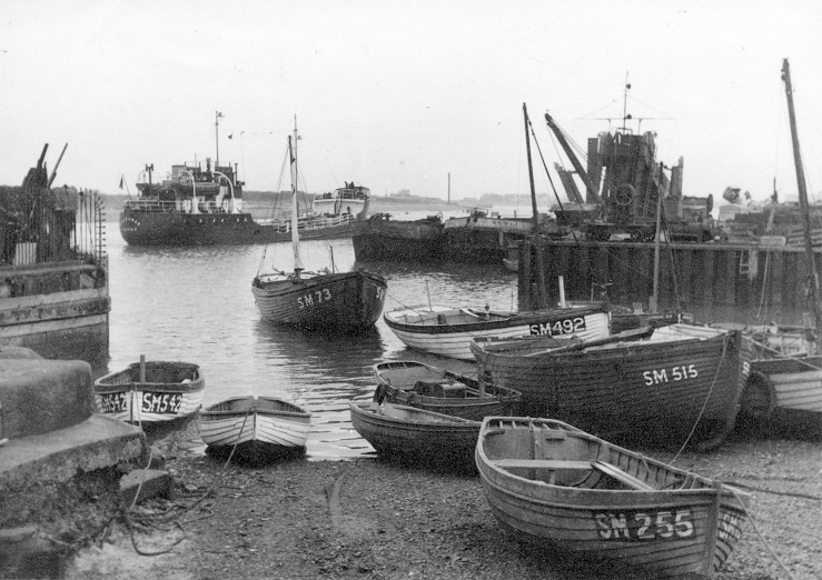 Small boats moored on the banks of the harbour