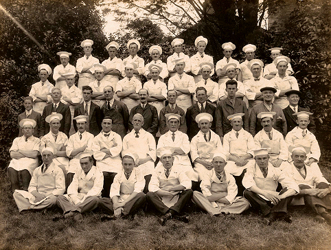 Black and white photograph. Group of 47 staff arranged in five rows.
